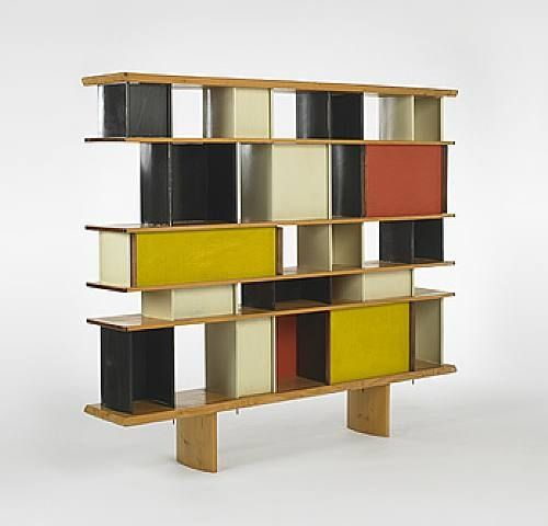 a bookshelf by Charlotte Perriand at Atelier Jean Prouvé, made in 1953