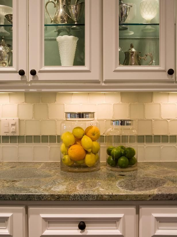 Like that tile! And the cream outside/ green #interior of the cabinets. Light fixtures installed underneath cabinets can accentuate beautiful countertops and provide increased visibility for prepping food.