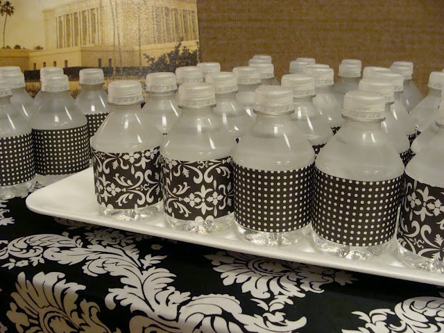 Patterned duct tape or scrapbook paper to dress up water bottles..  LOVE THIS IDEA!!! I will be using it for sure!!!
