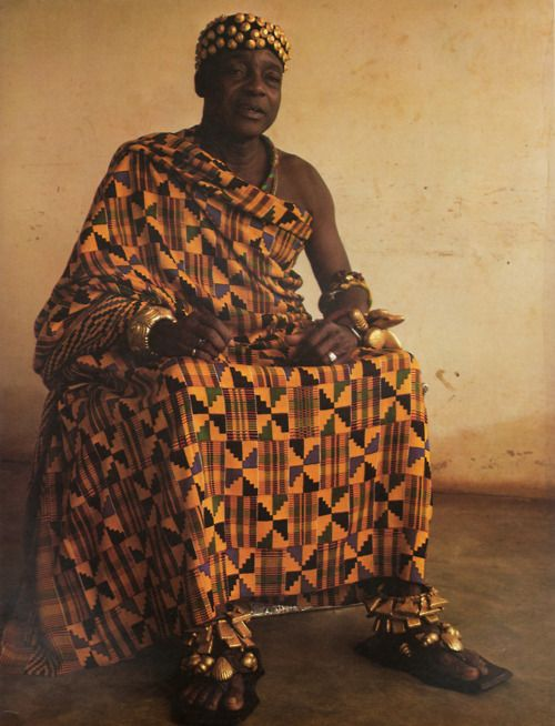 This man is in kente cloth, that is made by Ghana people.  This is the typical men's clothing for an average day.