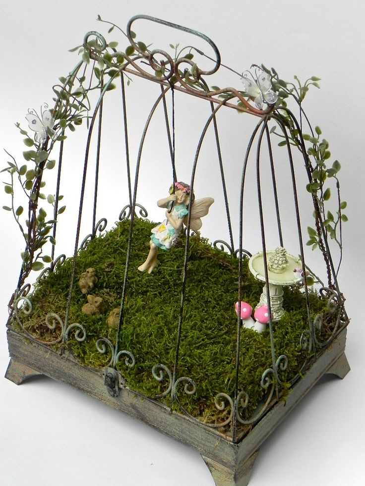 Miniature Fairy Garden with this Lovely Little Fairy on her Swing.