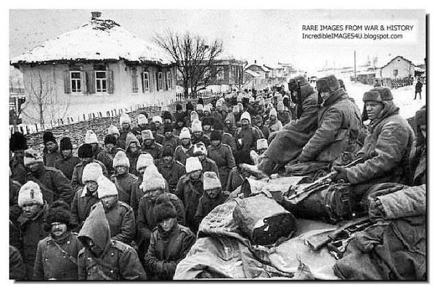 ILLUSTRATED HISTORY: RELIVE THE TIMES: Unseen Pictures From Battle Of Stalingrad: Romanian POW file past as beady-eyed tough Russian soldiers keep watch