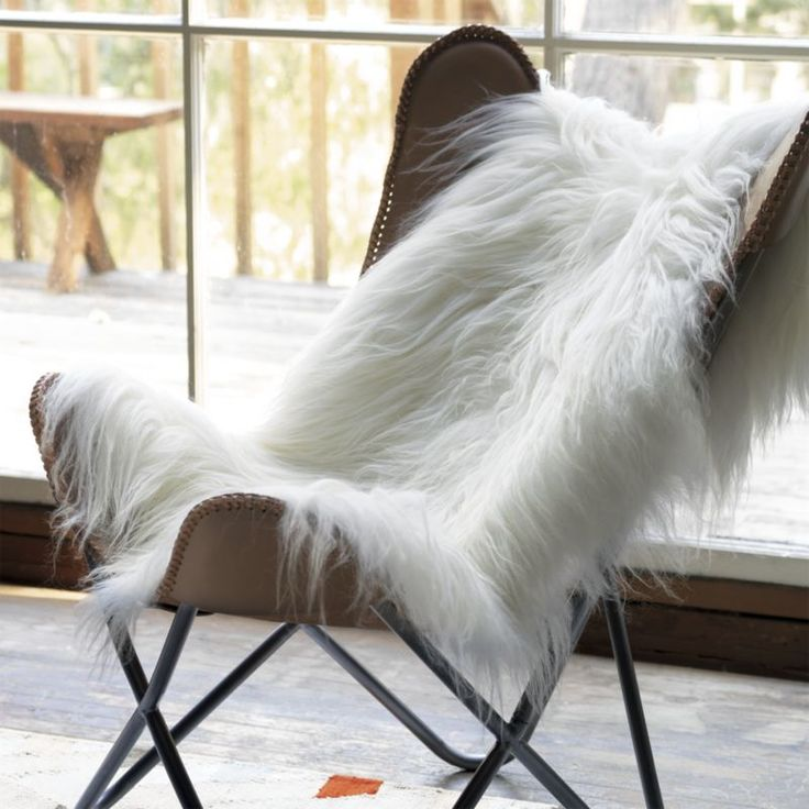 icelandic sheepskin throw    CB2 This is a cool and sexy way to add texture to a room without using shag rug...