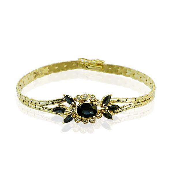 Vintage Schmuck, von Privat im Auftrag, Elegantes Geschmeide für Ihr zartes Handgelenk. Dieses gelbgoldene Armband trägt im Schmuckteil einen ovalen Saphir 1,572 ct., 6 Saphir Nav...