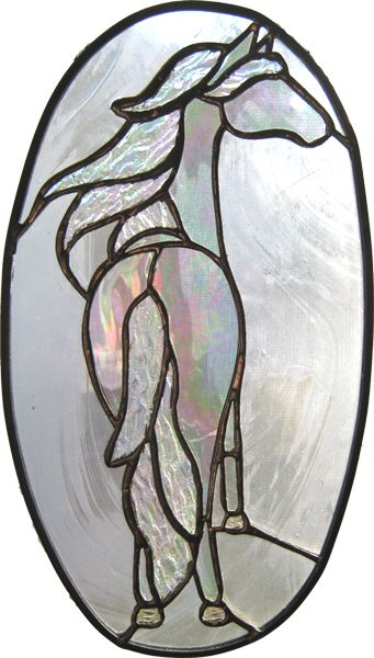 This elegant clear glass piece is a stained glass horse that is different and has an unusual perspective is created by EquineArtglass.com