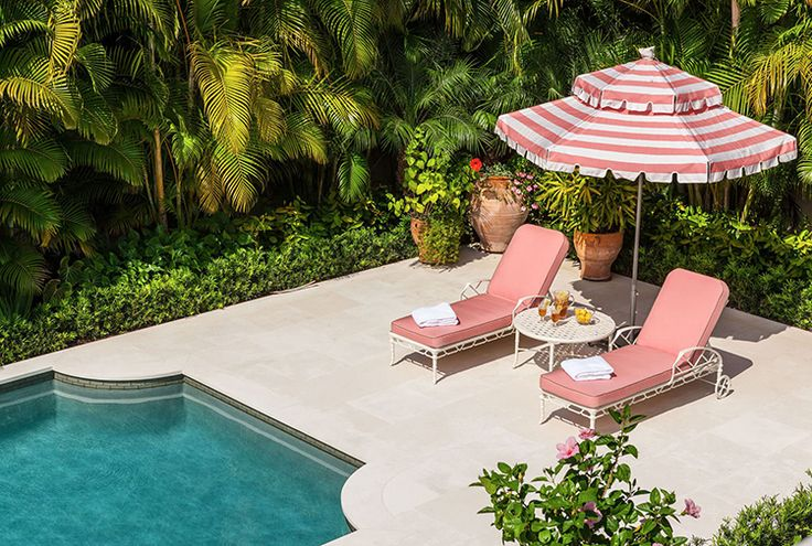 Summer Decorating Ideas. Pink outdoor furniture on a pool surround by McCann Design Group.