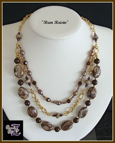 "Mocha, burgundy and gold triple strand. Gold accents and chain are gold plated brass. Necklace strands fall from 19"" to 23"" $60 Sold but similar to ""Fashion"""