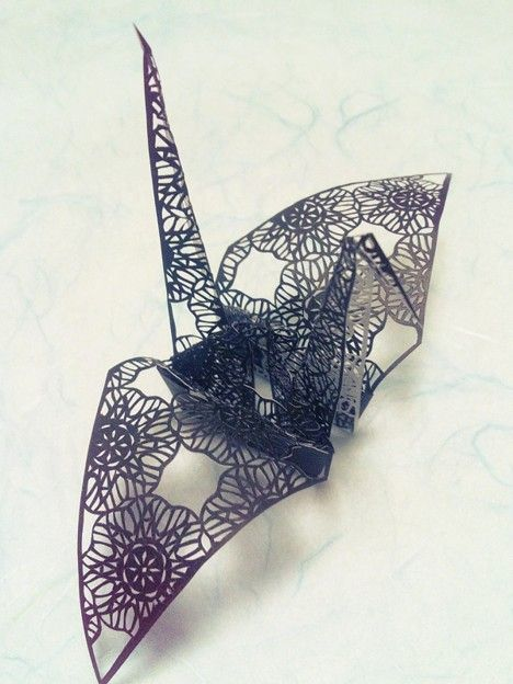 Japanese origami crane made with cut-out paper