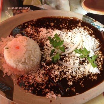 Photo of La Morenita Oaxaquena Restaurant - Los Angeles, CA, United States. Mole with cheese and rice.  order mole negro oaxaqueno...classic dish here