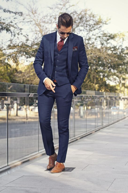 Mens fashion: 3 piece navy suit, burgundy tie, paisley pocket square, tan oxfords