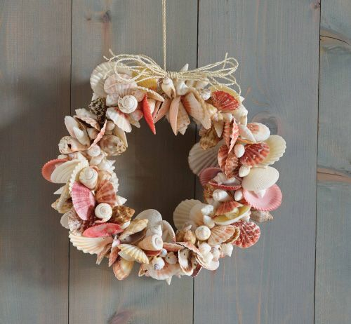 Shell Wreath. Each wreath is hand-made using natural found seashells. Each shell is drilled and wired by hand.