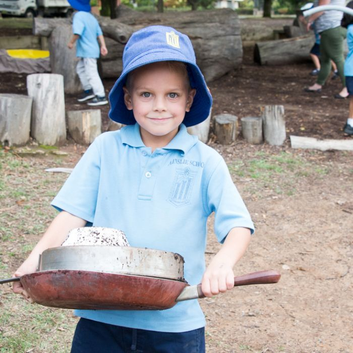 Cubby houses, mud kitchens and castles are some of the creative things students are making from recycled junk at a Canberra primary school.