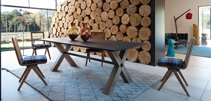 Solid oak, slate, metal tube.  Legs in solid oak with vintage finish. The cracks resulting from the drying and the aging of the wood are visible and make each table unique.  The legs are connected by a metal tube, with nut and washer assembly.  - Top in natural slate with a slightly corrected finish. The differences remain visible, and each top has a distinctive pattern.  - Top in glass (dining table with top in 19 mm thick glass or 12 mm tempered glass, cocktail table with top in 15 mm…
