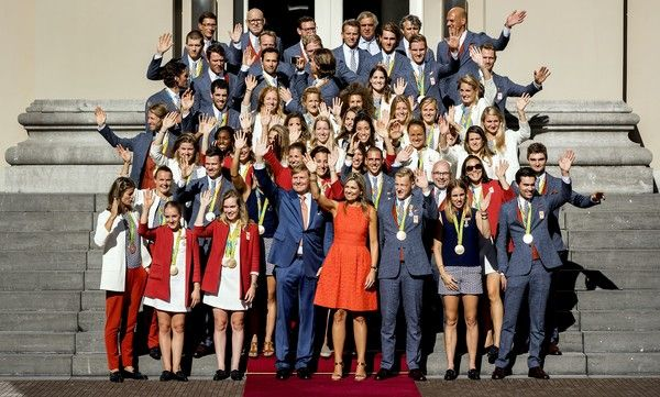 Queen Maxima Photos Photos - King Willem-Alexander (C, left) and Queen Maxima (C, right) pose with Olympic medal winners at the Palace Noordeinde on August 24, 2016 in The Hague.  / AFP / ANP / Koen van Weel / Netherlands OUT - In Focus: The Royal Week