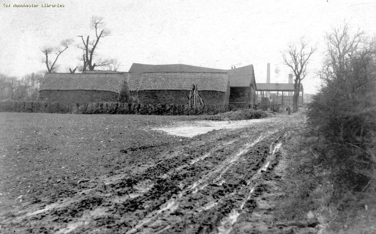 Fields and farm sheds in Moss Side, with factory chimneys encroaching in the background (1895)