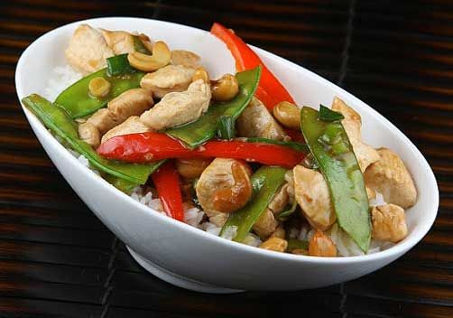 Garlic Chicken Stir Fry: canola oil, snow peas, cashew nuts, garlic, green bell pepper, soy sauce, ground ginger, sliced green onions, low sodium chicken broth, canola oil, boneless chicken breast, garlic, green bell pepper, snow peas, cashew nuts, sliced green onions, low sodium chicken broth, soy sauce, corn starch, ground ginger