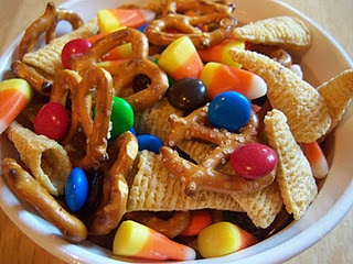 "Thanksgiving ""cornucopia"" snack mix.  Can replace m and ms with candy corn pumpkins or candy corn.  (bugles, pretzels, chex mix, craisins)  serve in turkey cups"