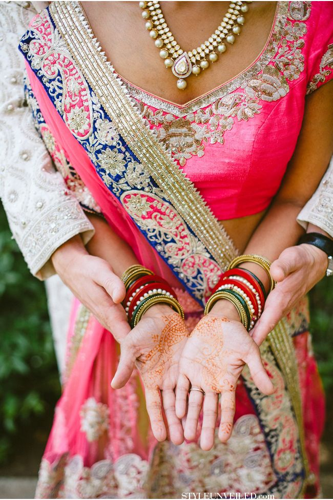A pink bride with blue and gold to help make the colors pop. The Indian influence is here and we love it.