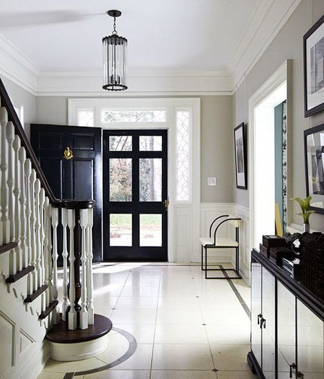Beautiful painted floors, door, screen door. The curved stripe is a great