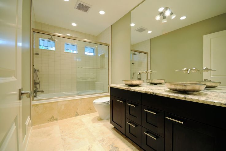 Bathroom2: Black Stained Wooden Vanity Cabinet Set With Beige Polished Quartz Top Chrome Oval Vessel Sink Large Wall Mirror Brown Marble Flooring Frameless Glass Shower Door from Elegant Bathroom Vanity Cabinets Made of Wood