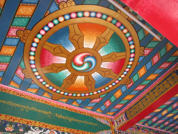 A tibetan library of works and archives. Posted on September 25,  2009. This wheel of dharma  is  depicted on the celing of the entrance of the library.