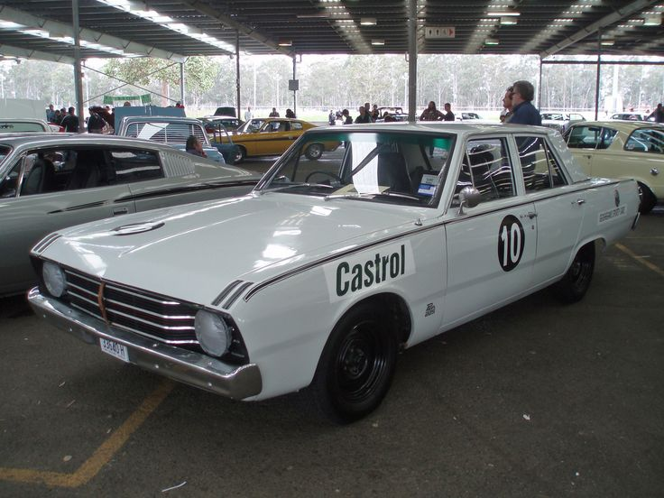 1969 Chrysler VF Valiant Pacer sedan. Restored as a replica of the Pacer raced by Chrysler factory driver Leo Geoghegan. Taken at the 2006 New South Wales All Chrysler Day, held at Fairfield Showground, Prairiewood, Sydney.