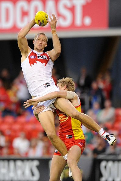 Sam Reid of the Swans marks the ball during the round 12 AFL match between the Gold Coast Suns and Sydney Swans at Metricon Stadium on June ...