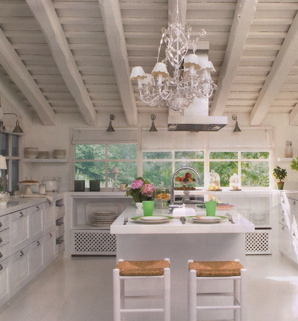 Super wonderful white kitchen, large beams, slanted roof, center island, chandelier with white shades via:DESDE MY VENTANA: Un cocina Blanca / A White Kitchen