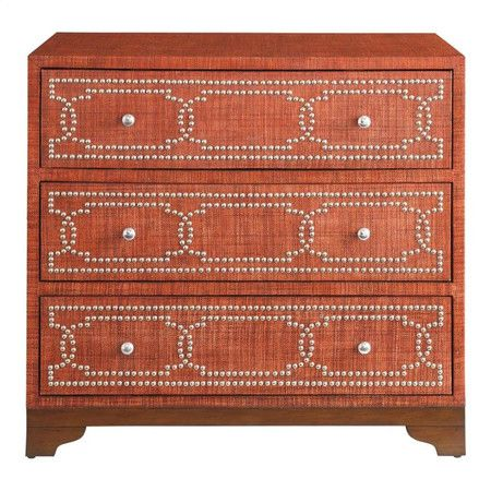 Make a stylish statement in your master suite or den with this bold chest, showcasing a red finish and geometric nailhead trim.Produc...