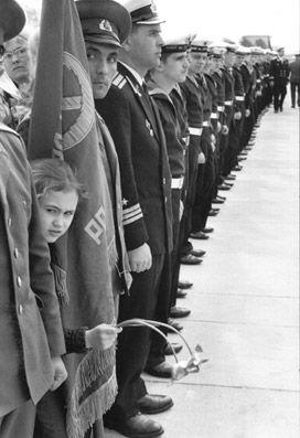 Henri Cartier Bresson - Leningrad, USSR, 1973.   Little girls and flowers will always threaten warriors. -k.