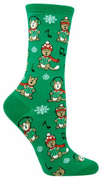 Green crew length women's sock with caroling cats dressed in winter gear, with snowflakes and music notes!