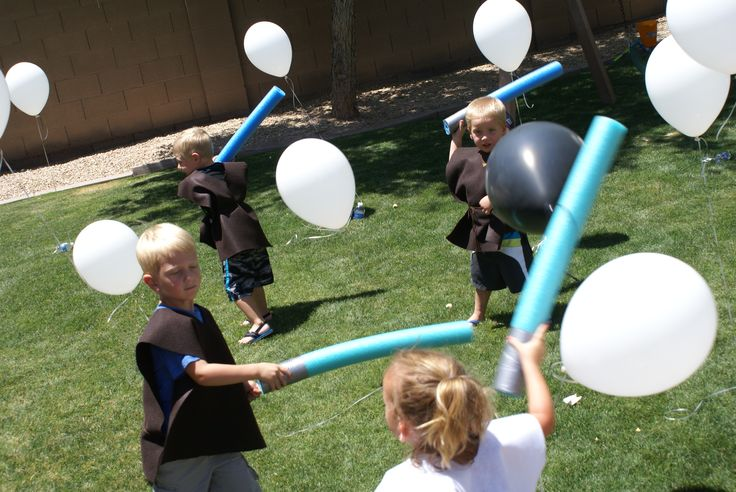 Fighting Storm trooper and Darth Vader Balloons with light sabers #Star Wars birthday party