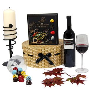 This hamper contains a combination of delicious Lir chocolate and Italian red wine accompanied by a stunning candle holder with cream pillar candle that any recipient will enjoy, suitable as a birthday gift.