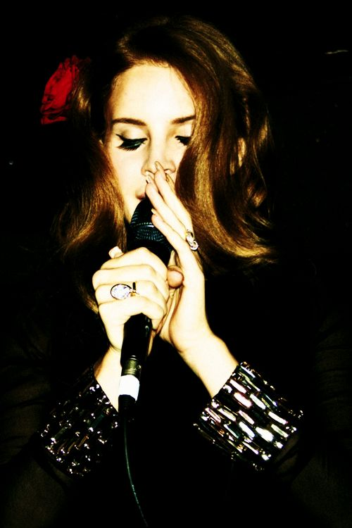 With a passion as red as rose in her hair, she sings<3