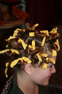 We do this every year for girls camp!  Just strips of fabric, wrap the hair like you would a spounge curler and tie!  Cheap and easy!