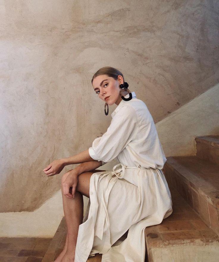 tonal white on white outfit – white blouse, white skirt, dramatic earrings – cas…