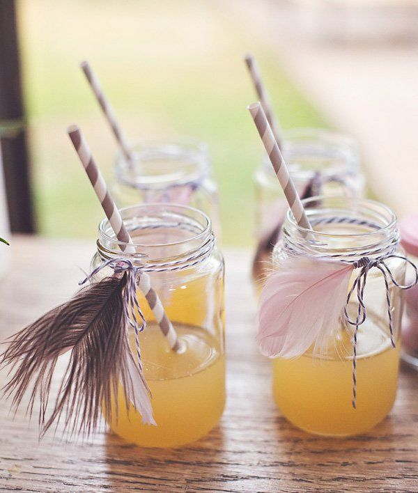 mason jar drinks with feather decorations