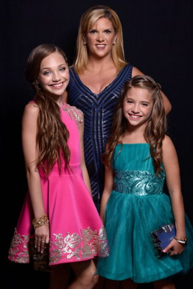 Maddie Ziegler made a public appearance with her mother, Melissa Gissoni, and her sister, Mackenzie Ziegler at the Teen Choice Awards 2014 [2014]