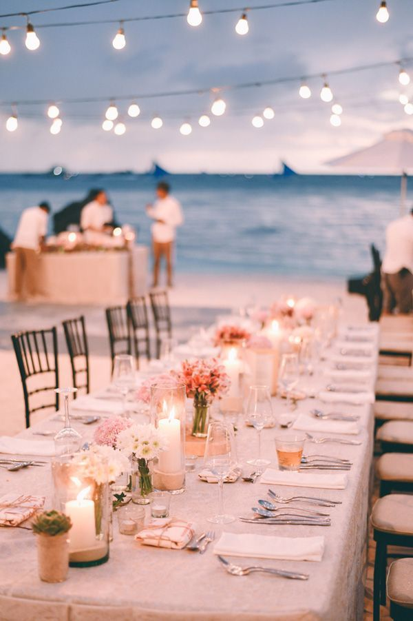 This Boracay beach wedding got it, spot on! From the engagement photos of the couple in simple outfits walking along the shore, to the wedding setup of hanging bulbs, white, clean table settings, and sunset glow, we are absolutely astounded by the beauty of natural simplicity.