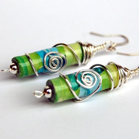 Long glass bead earrings complemented by wire bead cap and