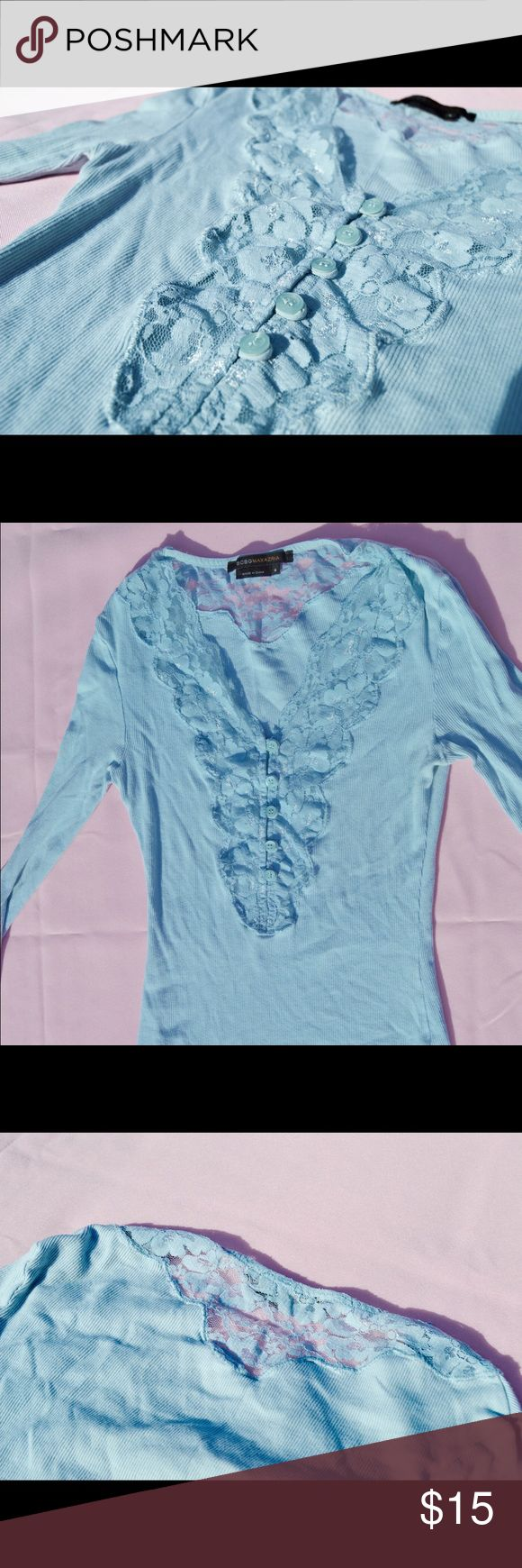 BCBG Max Azria Blue Lace Long Sleeve Shirt The details are really what make this top gorgeous - from the loop buttons to the delicate lace with a scallop trim. The deep v underneath the lace gives it the perfect edge! BCBGMaxAzria Tops