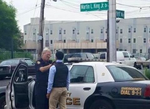 Photo of Jersey City cop showing youngster how to tie a tie goes viral....wish more cops made the news with our community this way. Still, makes you smile and sigh all at once.