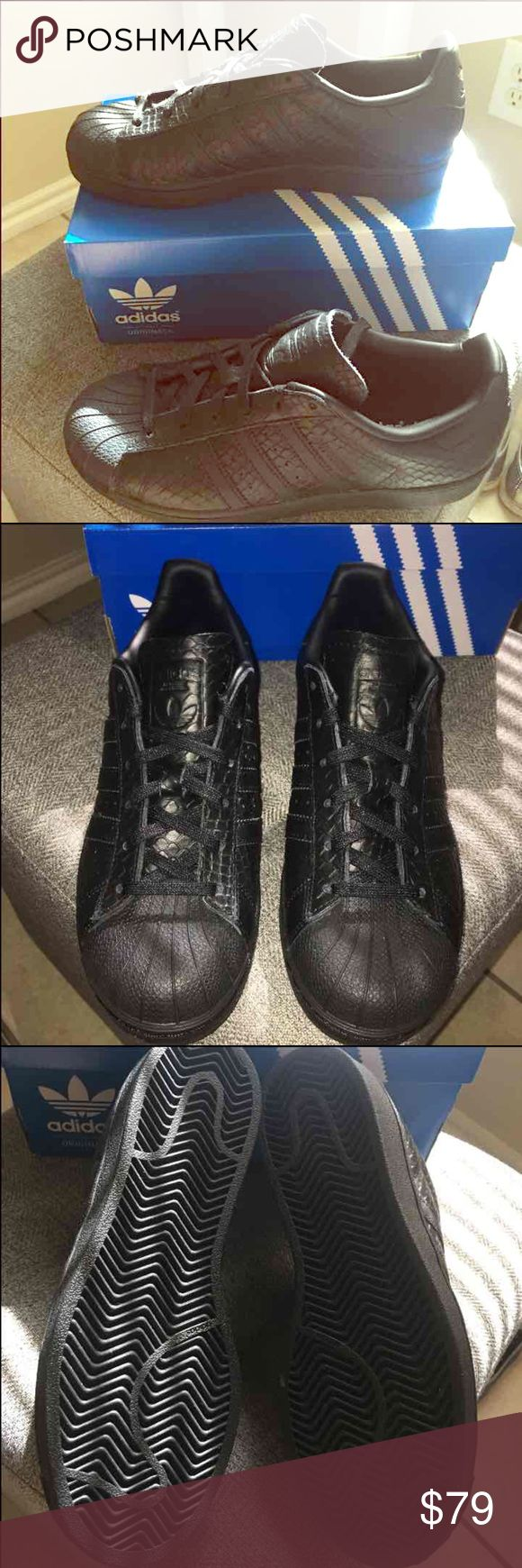 Authentic Adidas superstar textured black snake. NWT Adidas superstar textured black snake. 100% authentic  Size 7 ( I'm size 7.5 and this fits me perfectly but please be sure it is your size before buying). Box included. PRICE IS FIRM:) NO TRADES:) Adidas Shoes Sneakers