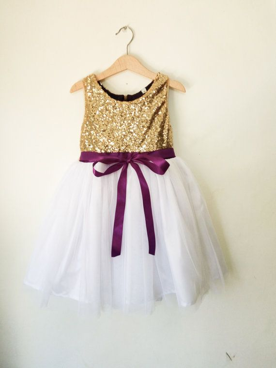 Gold sequined flower girls dress with white or ivory tulle skirt and purple satin ribbon. Perfect for a wedding attend dress, flower girl dress,