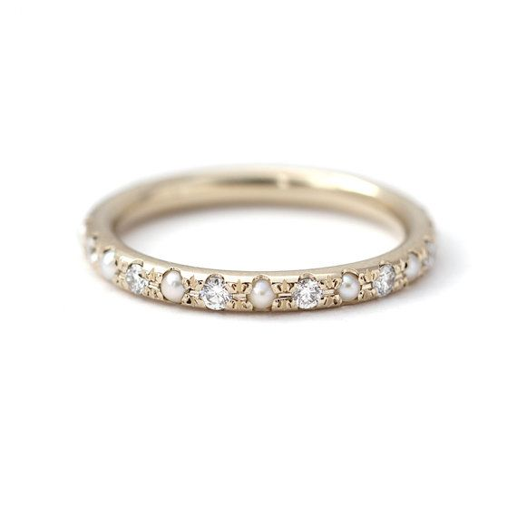 Full eternity ring with 2 mm diamonds and white pearls. Bold and unique wedding ring.  Materials: 18k solid gold, conflict free diamonds, natural freshwater 2 mm white pearls Ring width: 2.5 mm Diamonds total carat weight: 0.38 carat (for a ring is size 6)  Available in YELLOW, WHITE or ROSE 18k gold.  (!) Information about Our White Gold: We do not add rhodium plating to our gold items; the natural color of the white gold is retained. As a result, the color may have a yellowish or greyish…