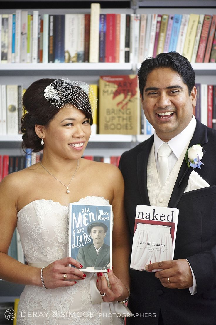 Quirky & humorous wedding couple portraits in an old book store
