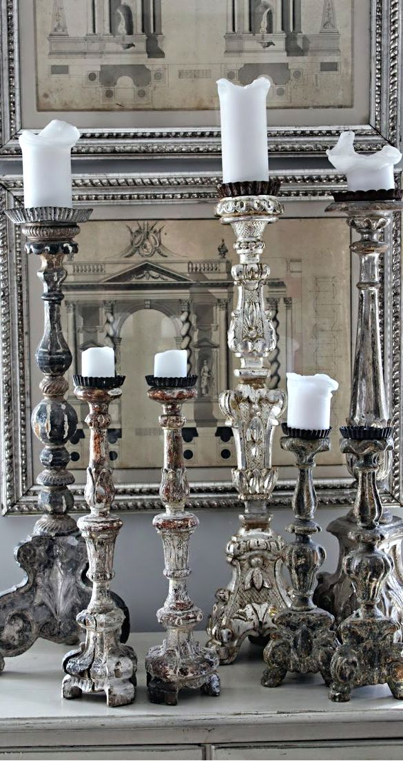 Altar candles and architectural prints
