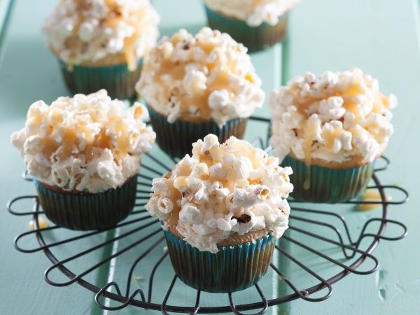 Butter popcorn cupcakes • Crunchy, bite-size popcorn cakes topped with buttercream icing and drizzled with a buttery, caramel sauce – need we say more?