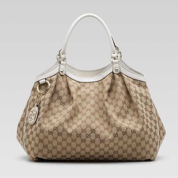 Gucci Sukey Large Tote, purchased first when they embossed around the eddges.