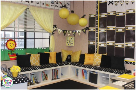 Classroom Library with book storage under reading benches (which are really tall IKEA book cases tipped on their sides!)